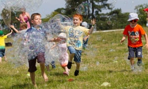 Kids enjoying bubble-blowing at the Deer Shed Festival, North Yorkshire.