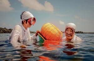 Jeju, South Korea: Ja Kang Song, 71, and Ja Hyun Su, 72, two diving women of Jeju