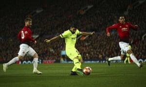 Barcelona's Luis Suarez shoots.