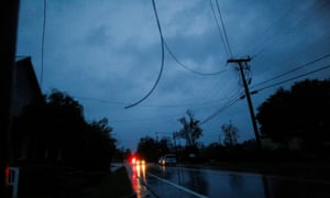 Power lines are seen hanging from a post during the passing of Florence in the town of New Bern.