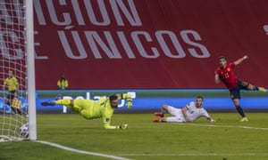 Ferran Torres (right) fires home and doubles Spain's lead.