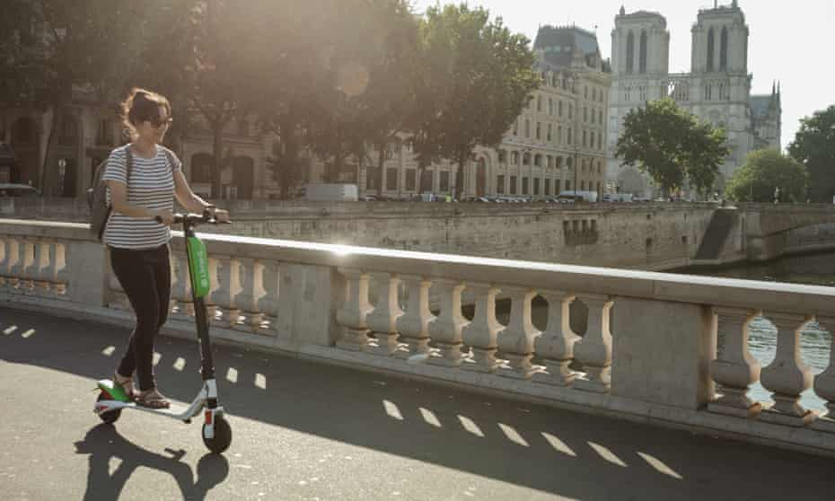 Katy Lee on a Lime e-scooter in Paris.
