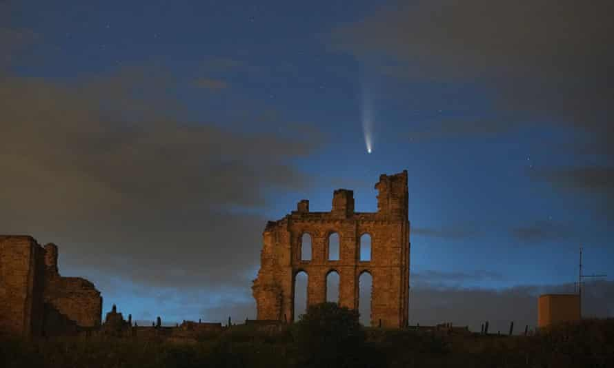 a comet passes over Tynemouth Priory.