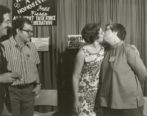 Barbara Gittings (left) and Isabel Miller kissing at a booth called 'Hug a Homosexual' at the 1971 American Library Association convention.