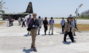 Journalists and Taiwan officials disembark at Taiping Island on Wednesday.