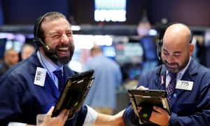 traders smile and joke at the NYSE