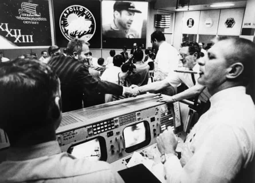 the scene at mission control minutes after the recovery of the apollo 13 crew. flight director gene kranz is on the far right with a cigar in his mouth