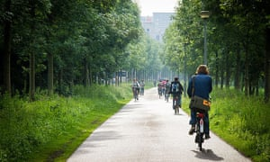 Cyclists on a bike path in Westerpark, Amsterdam.