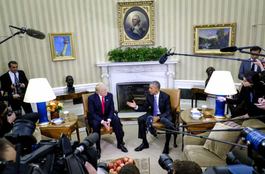 U.S. President Barack Obama, right, speaks as U.S. President-elect Donald Trump listens during a news conference in the Oval Office of the White House in Washington, D.C., U.S., on Thursday, Nov. 10, 2016.