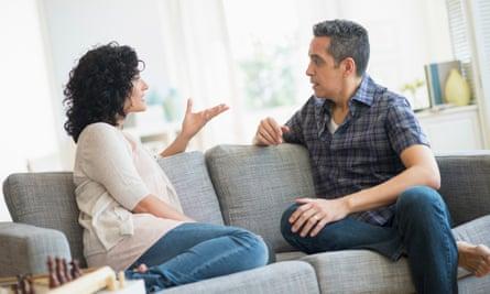 Couple talking on sofa