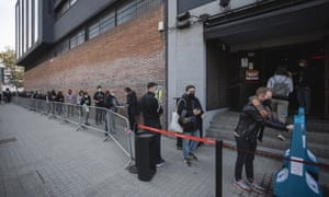 Audience is seen waiting a queue at Razzmatazz to get tested for Covid-19 with an antigen test before attending a concert by the Love of Lesbian music band at Palau Sant Jordi on March 27, 2021 in Barcelona, Spain.