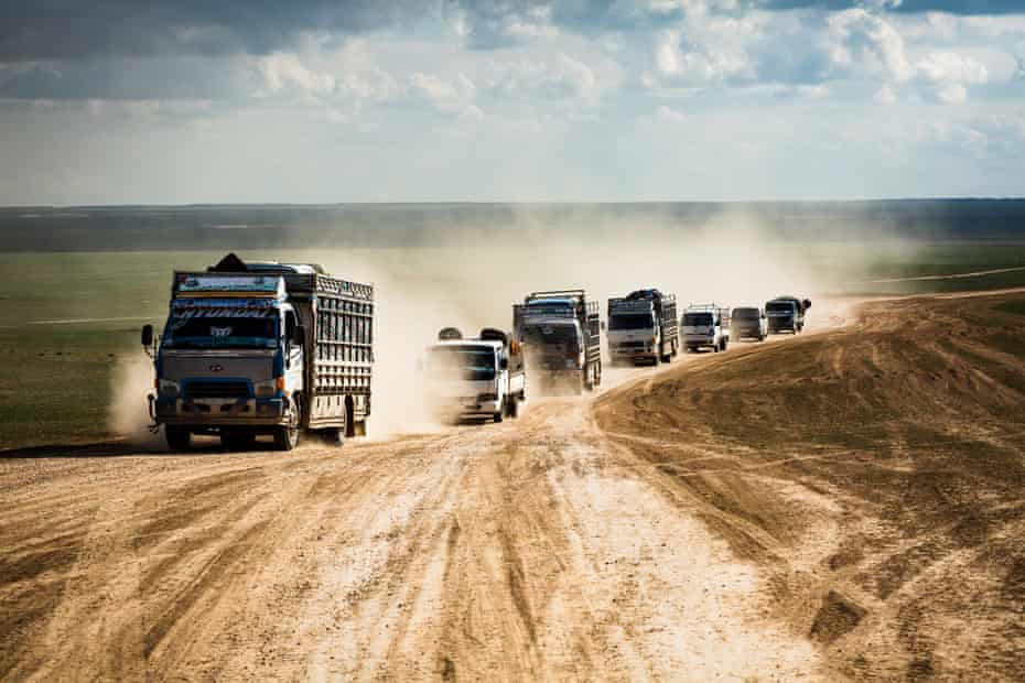 Trucks full of people arrive at a civilian screening point for suspected Isis families, on 11 February 2019