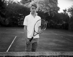 A boy with a tennis racquet