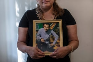Rosa, an immigrant from El Salvador, holds a photograph of her son José, 27, who is currently stuck in Juarez, Mexico, on 25 July.