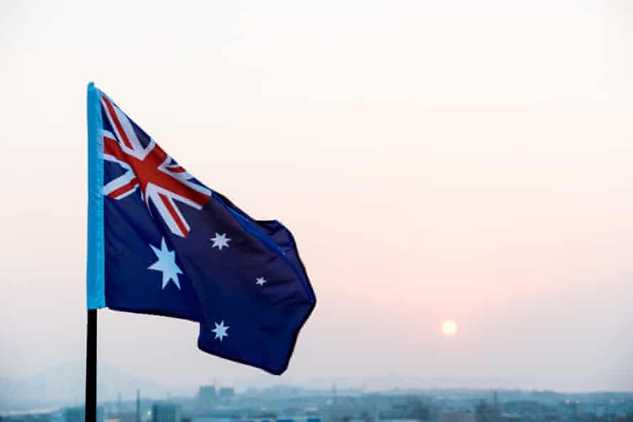 Australia national flag at sunset.