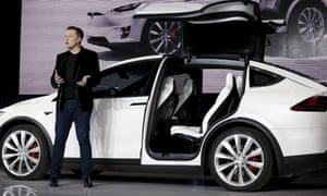 Elon Musk introducing the falcon wing door on the Model X electric sports-utility vehicles in Fremont, California, 2015