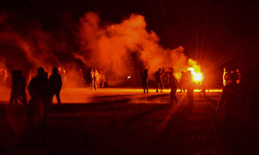 Police try to break up an unauthorized rave near Redon in Brittany, France, on Friday night.