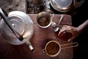 Helena makes tea to sell in her home in Rumbek