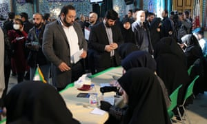 Iranians prepare to cast their ballots for the 11th Parliamentary elections in Tehran.