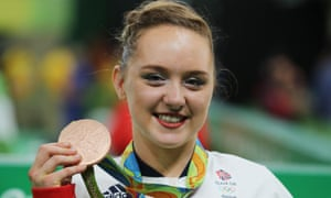 Amy Tinkler celebrates with her bronze medal at the Rio Olympics.