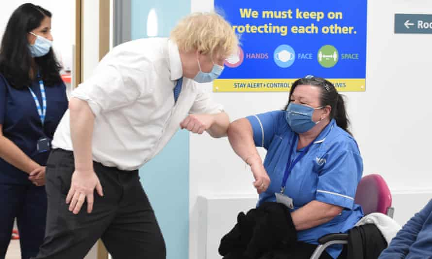 Boris Johnson bumps elbows with a nurse on a visit to a Covid vaccination centre in south-east London