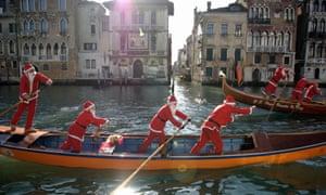 Gondoliers race through Venice's canals in seasonal attire.