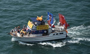 A boat on Sydney Harbour is decorated with Australian flags and a thank you message for firefighters.