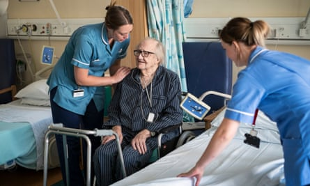 NHS nurses with a hospital patient