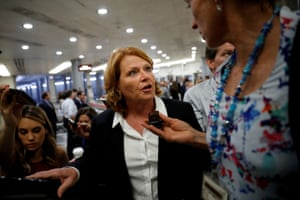 Then-senator Heidi Heitkamp speaks with reporters on Capitol Hill.