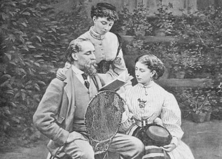 Charles Dickens reading to two of his daughters in the garden of his home, Gad's Hill, in Kent.