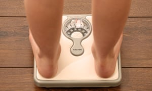 A girl on a set of weighing scales