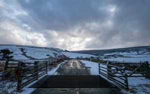 A cattle grid marks the entry point to the snow covered North Yorkshire moors