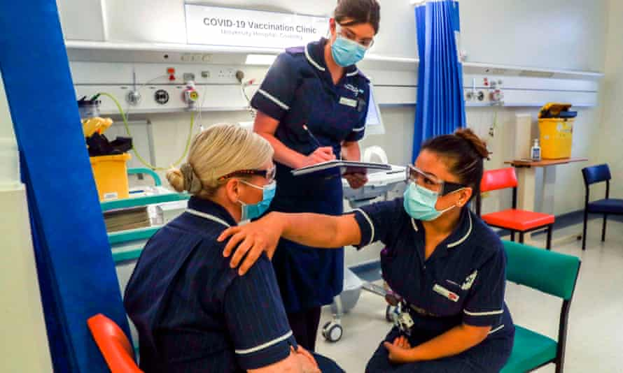 Medics at the University Hospital Coventry undergo training on administering jabs before the rollout of coronavirus vaccine across the UK.