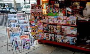 Newspapers and magazines for sale at a London newsstand
