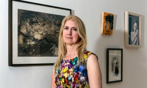 Jane Eccles, with some paintings from her collection. L-R: Peter Kettle 'Brecon Beacons 1', Bartosz Beda 'Iku Red', Bartosz Beda 'Poet', Julia Blackshaw ' Withdrawn'.
