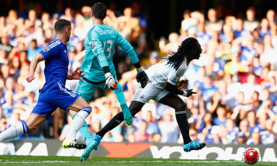 The Chelsea goalkeeper Thibaut Courtois brings down Swansea's Bafetimbi Gomis to give the visitors a chance to equalise from the spot. Courtois was sent off following this incident.