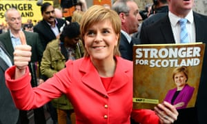 SNP leader and Scottish First Minister Nicola Sturgeon holds up a copy of the party's general election manifesto, as she launched it in Edinburgh