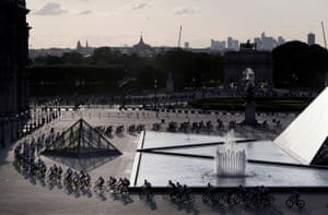 The pack rides through the courtyard of the Louvre museum in Paris during the 21st and final stage of the Tour de France.