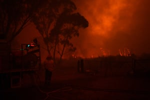 RFS crews fight to protect homes along the Old Hume Highway near the town of Tahmoor as the Green Wattle Creek fire threatens a number of communities in the south-west of Sydney