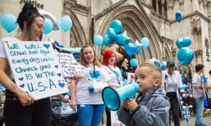 Supporters of terminally ill baby Charlie Gard protest outside the High Court on July 24, 2017 in London, England.