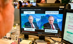 "A AFP journalist views a video on January 25, 2019, manipulated with artificial intelligence to potentially deceive viewers, or ""deepfake"" at his newsdesk in Washington, DC"