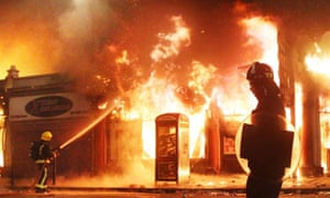 A building burns in Tottenham during the riots of August 2011