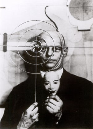Oskar Schlemmer holding a mask, 1930 'My themes – the human figure in space, its moving and stationary functions, sitting, lying, walking, standing – are as simple as they are universally valid,' he once said of his work. 'They are inexhaustible'