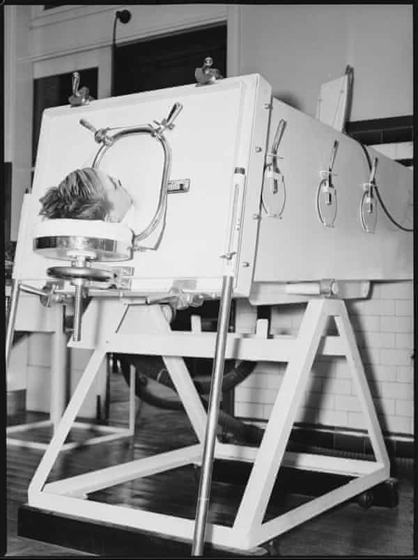 A child lies in an iron lung at the Children's Hospital 20 May 1938.