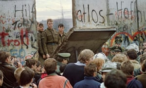 East German border guards demolishing a section of the Berlin Wall, 11 November 1989.