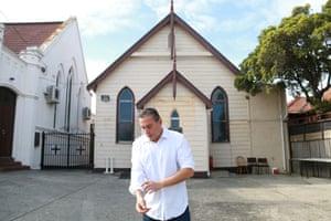 Christos Tsiolkas outside a church.