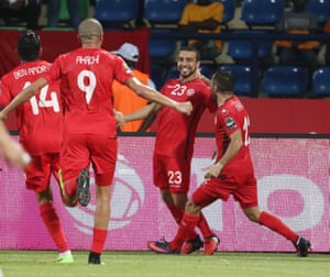 Naim Sliti, second right, is congratulated by his team-mates after he doubled Tunisia's lead.