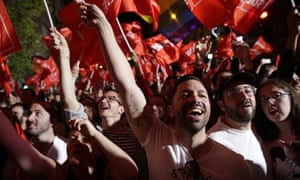 Supporters of Spanish prime minister and Socialist party candidate Pedro Sanchez react as they gather at the party headquarters waiting for results of the general election in Madrid.