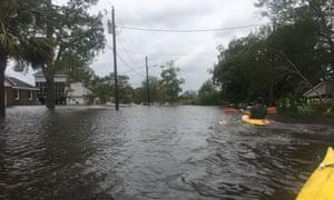 Jacksonville resident Art Ferreiro kayaks around his flooded neighbourhood.