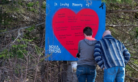 People pay their respects at a roadside memorial in Portapique, Nova Scotia., of 22 people killed in a mass shooting on 26 April.